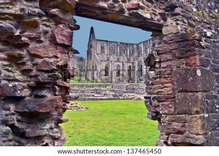 A view of the ruins of Tintern Abbey found in Wales.  Tintern is one of the many religious buildings that was destroyed by Henry VIII. - stock photo
