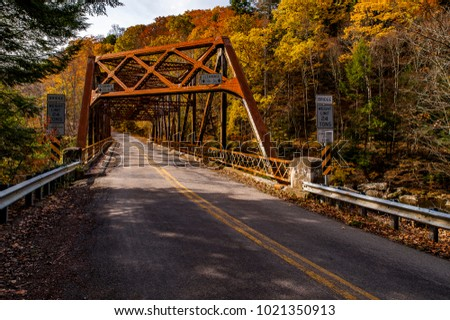A view of the rusty Mountville Road Bridge in Lawrence County, Pennsylvania on an autumn afternoon.