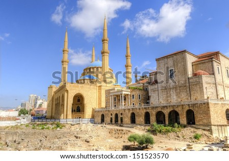 A view of the Saint George Maronite Cathedral and the Mohammad Al-Amin Mosque at the historic centre of Beirut, in Lebanon, down town. Ancient Roman, Hellenistic, Byzantine ruins on the foreground. - stock photo