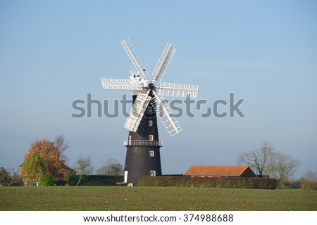 A view of the Sibsey Trader Mill. showing its unusual six-sail construction.  The windmill is one of the  few six-sailed mills still remaining in England and is fully operational