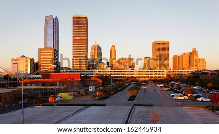 A view of the skyline of Oklahoma City at sunrise. - stock photo