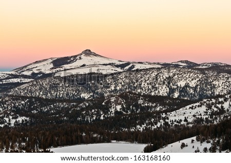 A view of the Stevens Peak against the background of golden sunset shot from highway 88, Lake Tahoe region, California, USA.