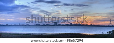 A View of the Sunset Behind the Port in Charleston Harbor - stock photo