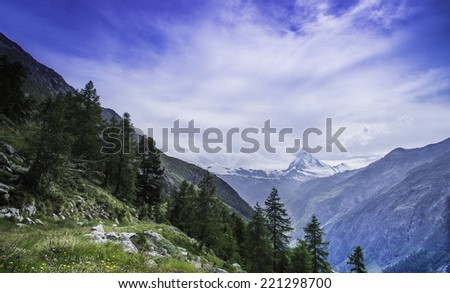 A view of the Zermatt valley, Switzerland with the Matterhorn mountain in the distance. - stock photo