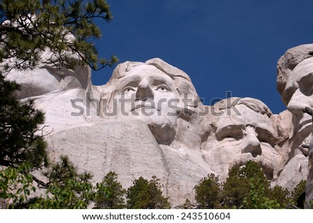 A view of Thomas Jefferson and Theodore Roosevelt on Mount Rushmore. - stock photo