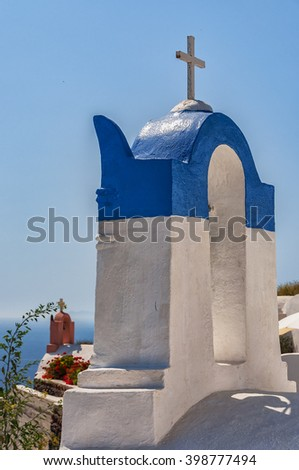 A view of two church bell towers from Oia on the greek isle of Santorini.