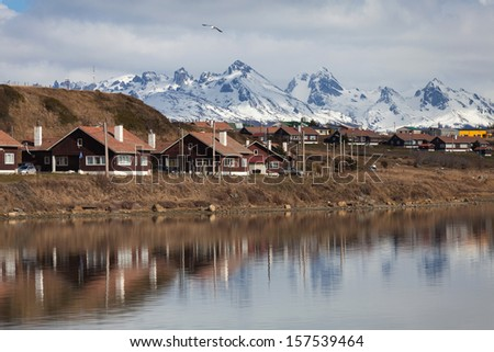 A view of Ushuaia, Tierra del Fuego. Boats line the harbor in Us - stock photo