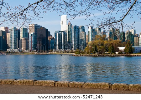 A view of Vancouver downtown from Stanley Park Sea Walk. - stock photo