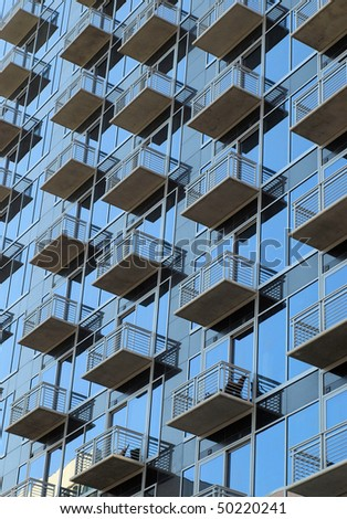 A view of window porches in an urban high rise - stock photo