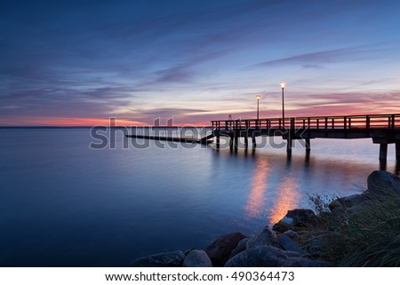 A view of wooden pier at sunset time. Port of Kuznica on Hel Peninsula. Poland.