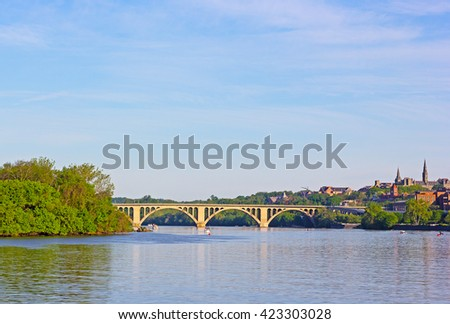 A view on Key Bridge and Potomac River, Washington DC, USA. Recreational water activities on the river in an early morning. - stock photo