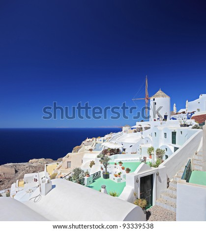 A view over a village on Santorini island in Greece - stock photo