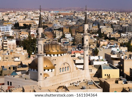 A view over the town center of Madaba in Jordan with the Central Mosque - stock photo