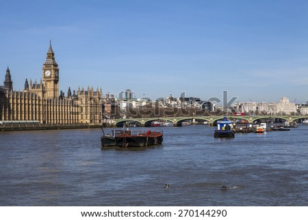 A view taking in the sights of the Houses of Parliament, Big Ben, Westminster Bridge, Charing Cross Station and the River Thames in London. - stock photo