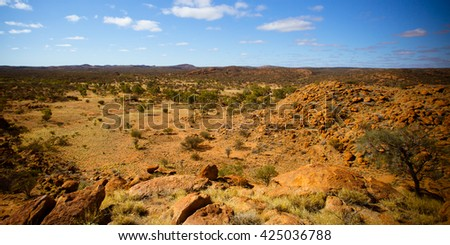 A view towards the West Macdonnell Ranges from near the Old Telegraph Station in Alice Springs, Northern Territory, Australia - stock photo