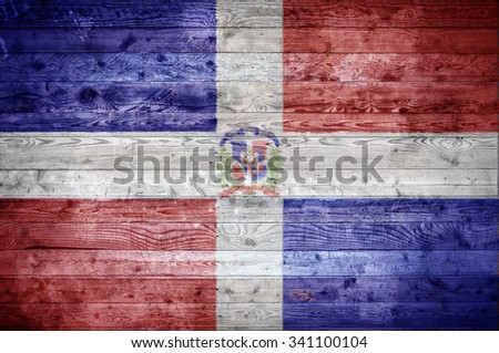 A vignetted background image of the flag of Dominican Republic painted onto wooden boards of a wall or floor. - stock photo