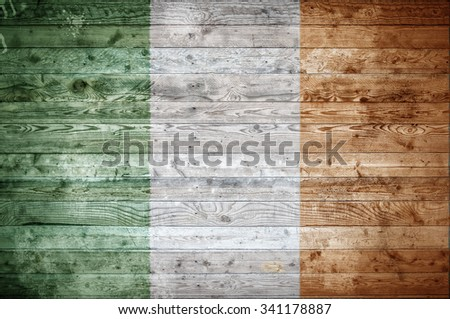 A vignetted background image of the flag of Ireland painted onto wooden boards of a wall or floor.