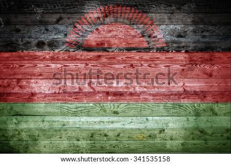 A vignetted background image of the flag of Malawi painted onto wooden boards of a wall or floor. - stock photo