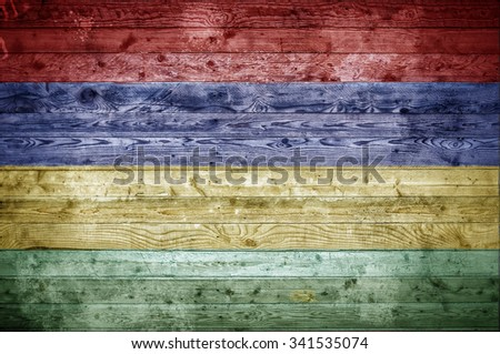 A vignetted background image of the flag of Mauritius painted onto wooden boards of a wall or floor. - stock photo