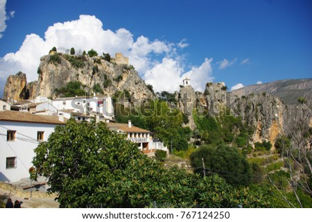 A village of Guadalest with a castle on a mountain top