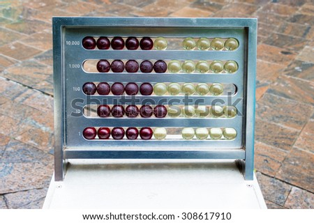 A vintage abacus placed in a urban contest - stock photo