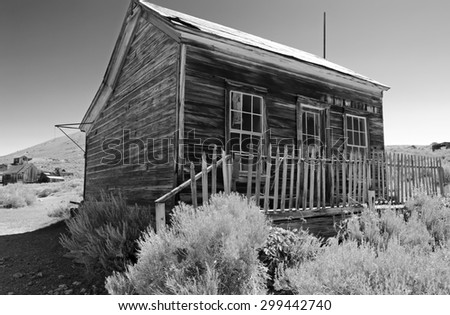 A vintage building in the remote high desert ghost town of Bodie, California, shown in black and white. - stock photo