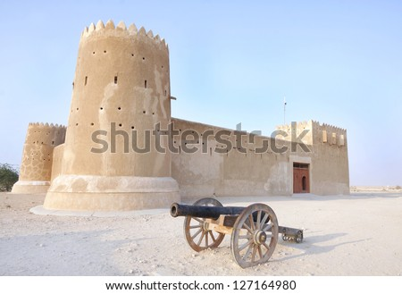 A vintage canon & Zubarah fort, Qatar - stock photo