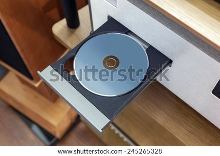 A vintage cd player with cd - stock photo