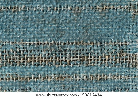 A vintage cloth book cover with a blue screen pattern and grunge background textures