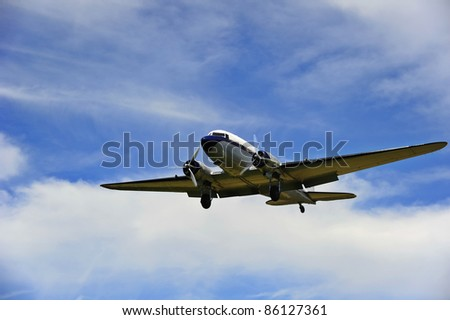 A vintage Douglas DC-3A (Dakota) coming in to land at an airfield - stock photo