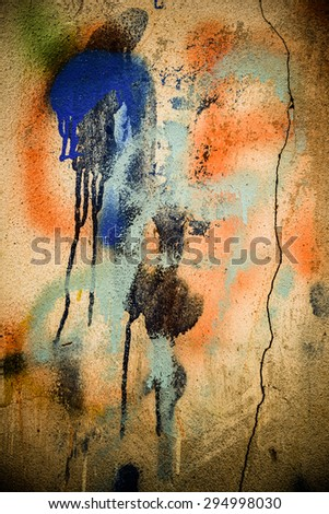 A vintage grunge background with patina-like colors, cracks, and golden brown and yellow paper textures. - stock photo