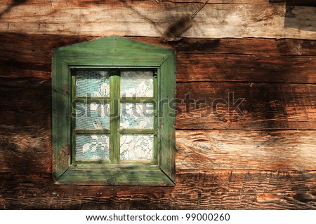 A vintage house window in nice sunlight - stock photo