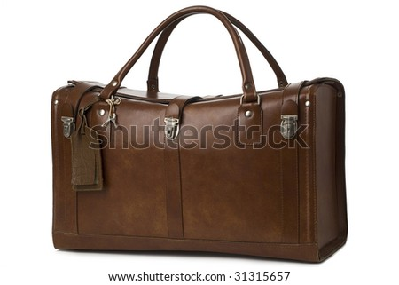 a vintage leather suitcase/bag against white background - stock photo