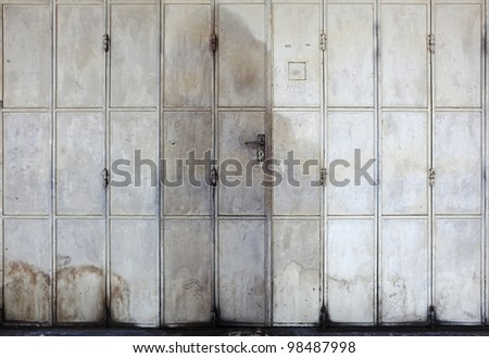 A vintage metal folding door for textural background. - stock photo