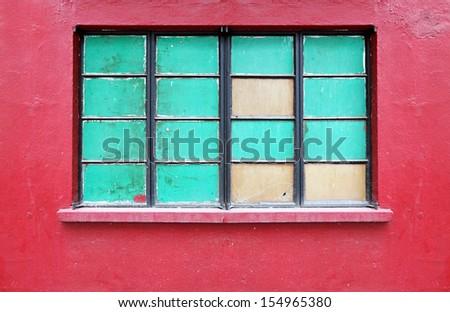 A vintage metal frame folding window on a red mason wall.  - stock photo