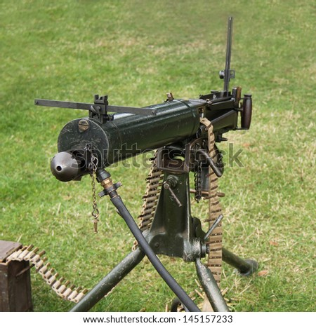 A Vintage Military Army Machine Gun with Ammunition.