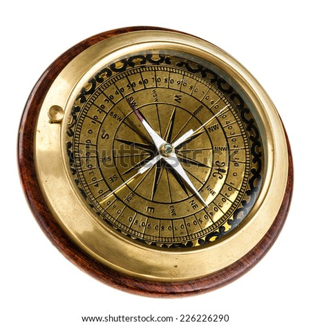 a vintage nautical table compass with golden parts and four needles