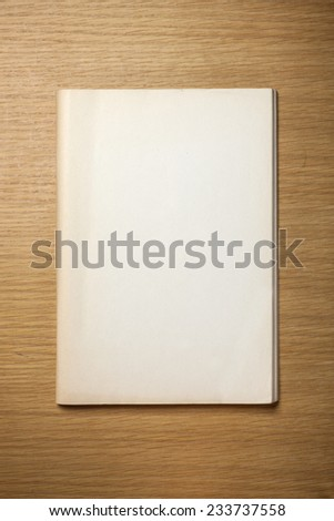 A vintage(old) book(note, diary) on the wooden desk, top view at the studio. - stock photo