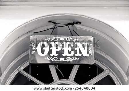 A vintage open sign hanging above a doorway - stock photo