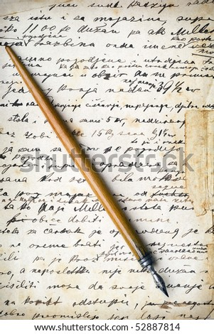 a vintage pen on a handwritten grunge paper - stock photo