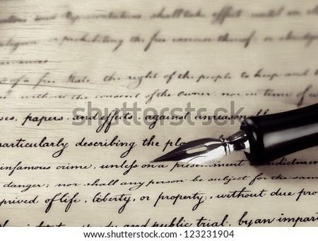 a vintage pen on a handwritten paper - stock photo