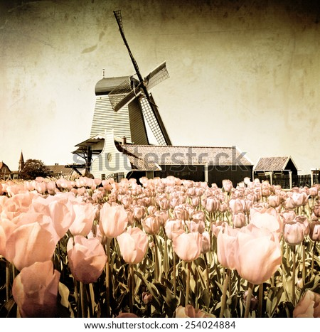 A vintage photo of windmill in Holland  - stock photo