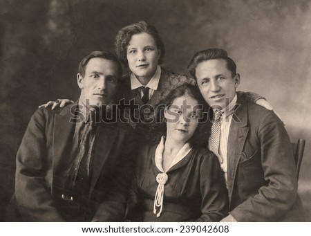 A vintage photo portrait from 1954 of Russian family. - stock photo