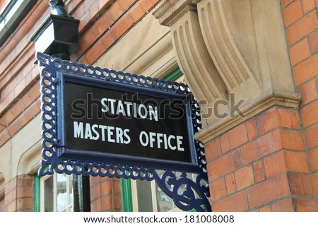 A Vintage Railway Station Masters Office Sign. - stock photo
