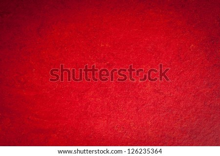 A vintage red background with a crisscross mesh pattern and grunge stains. - stock photo