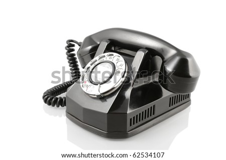 A vintage 1940-s Automatic Electric rotary telephone isolated on white with clipping path. Vintage black rotary phone (with clipping path) - stock photo