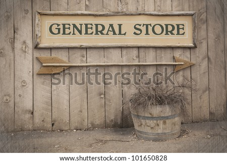 A vintage sign pointing to a General Store. Wild West theme . - stock photo
