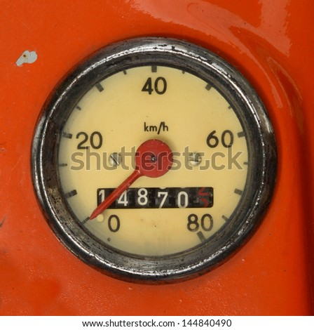 A Vintage Speedometer On A Red Scooter - stock photo