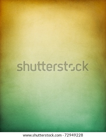 A vintage textured paper background with a brownish yellow to green gradient. - stock photo