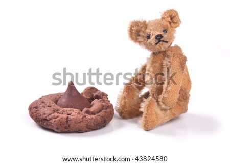 a vintage toy with a cookie. - stock photo